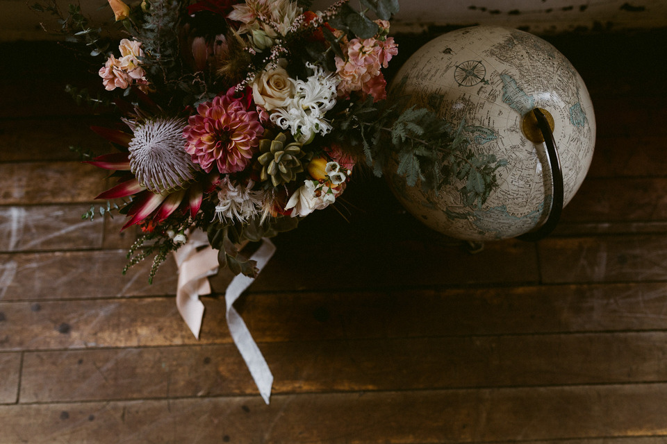 ampersand sf bridal bouquet and vintage globe