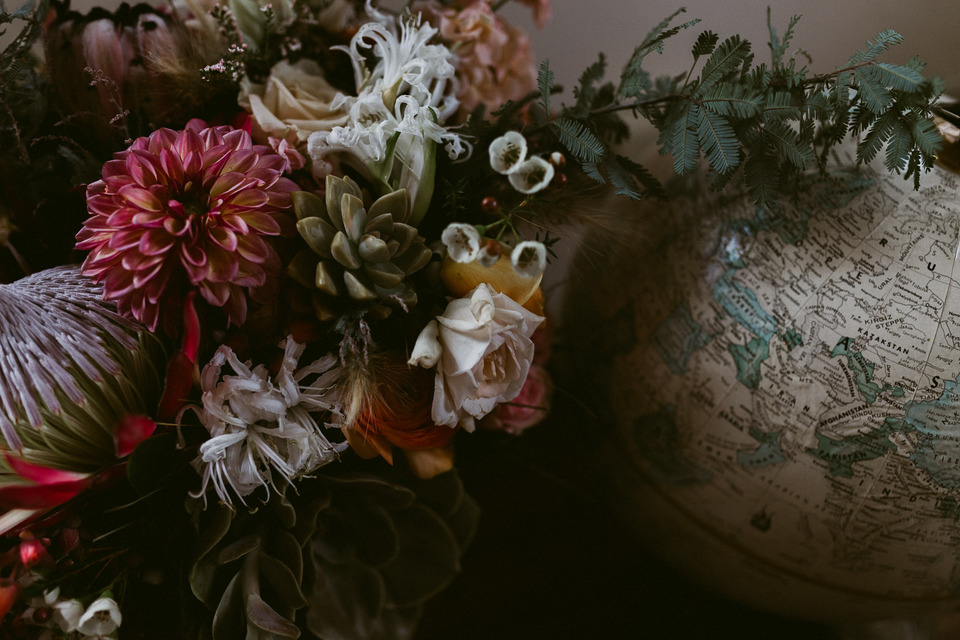 vintage globe and bridal bouquet by ampersanf sf